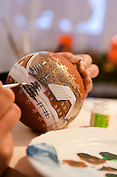 The finishing touches are being made to a hand-painted Christmas bauble