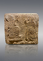 Alaca Hoyuk Sphinx Gate Hittite monumental relief sculpted orthostat stone panel. Andesite, Alaca, Corum, 1399 - 1301 B.C. Anatolian Civilisations Museum, Ankara, Turkey.<br /> <br /> Figure with a sharp and horned headdress (probably a god) sitting on a stool with a short backrest, with a figure (probably the figure of a king) worshipping to it. Both figures wear a large and ring-shaped earring. Among them is a hieroglyph, the symbol of divinity.<br /> <br /> Against a brown gray background.