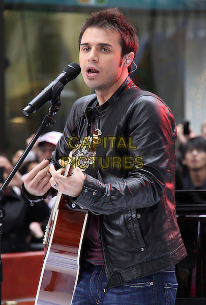 "KRIS ALLEN .American Idol winner Kris Allen performs live on NBC's ""Today Show"", New York, NY, USA, 28th May 2009..half length black leather jacket guitar playing microphone performing singing on stage playing live .CAP/ADM/PZ.©Paul Zimmerman/Admedia/Capital Pictures"