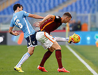 Calcio, Serie A: Roma vs Lazio. Roma, stadio Olimpico, 8 novembre 2015.<br /> Lazio's Marco Parolo, left, and Roma's Edin Dzeko fight for the ball during the Italian Serie A football match between Roma and Lazio at Rome's Olympic stadium, 8 November 2015.<br /> UPDATE IMAGES PRESS/Riccardo De Luca