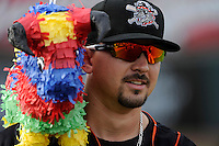 Erie Seawolves John Murrian #32 with a bull piñata before a game against the Binghamton Mets at Jerry Uht Park on June 23, 2012 in Erie, Pennsylvania.  Erie defeated Binghamton 5-3.  (Mike Janes/Four Seam Images)