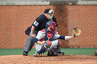 Florida Atlantic Owls catcher Ryan Miller (7) sets a target as home plate umpire Scott Graham looks on during the game against the Charlotte 49ers at Hayes Stadium on March 14, 2015 in Charlotte, North Carolina.  The Owls defeated the 49ers 8-3 in game one of a double header.  (Brian Westerholt/Four Seam Images)