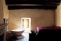 A stand alone bath tub in one of the guest bedrooms