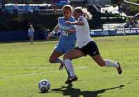 SAN DIEGO, CA - DECEMBER 02, 2012:  Alyssa Rich (00) of the University of North Carolina runs up to Emily Hurd (3) of Penn State University during the NCAA 2012 women's college championship match, at Torero Stadium, in San Diego, CA, on Sunday, December 02 2012. Carolina won 4-1.