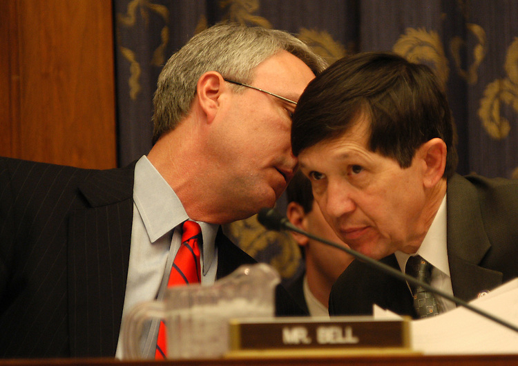 terror6/030303 - Rep. Chris Bell, D-Tx., talks with Rep. Dennis Kucinich, D-Ohio, at a House Committee on Government Reform hearing on strategies for fighting terrorism.