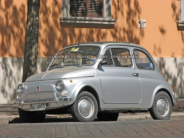 A metallic silver 1970's Fiat 500 L, Italian city car.