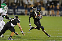 1 September 2011:  FIU's T.Y. Hilton (4) attempts to evade North Texas' K.C. Obi (46) in the first half as the FIU Golden Panthers defeated the University of North Texas, 41-16, at University Park Stadium in Miami, Florida.