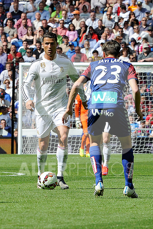 Real Madrid´s Cristiano Ronaldo and Eibar´s Javier Lara during 2014-15 La Liga match between Real Madrid and Eibar at Santiago Bernabeu stadium in Madrid, Spain. April 11, 2015. (ALTERPHOTOS/Luis Fernandez)