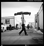 A trainer lifts a ski jumper so that he can practice his balance, Winter Olympics, Park City, Utah, February 2002