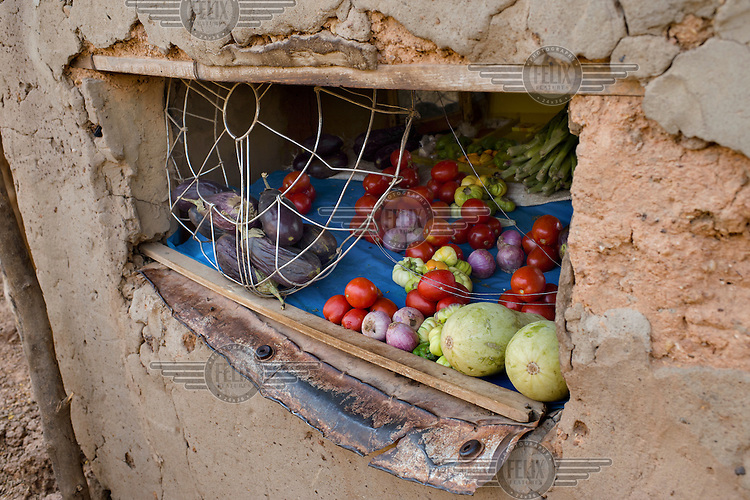Vegetables for sale displayed in a hatch in the wall at the home of Ernest Alassane Nana (45), a former photographer, in the informal settlement of Wapassi in Burkina Faso's capital. Nana now sells fresh vegetables for a living.