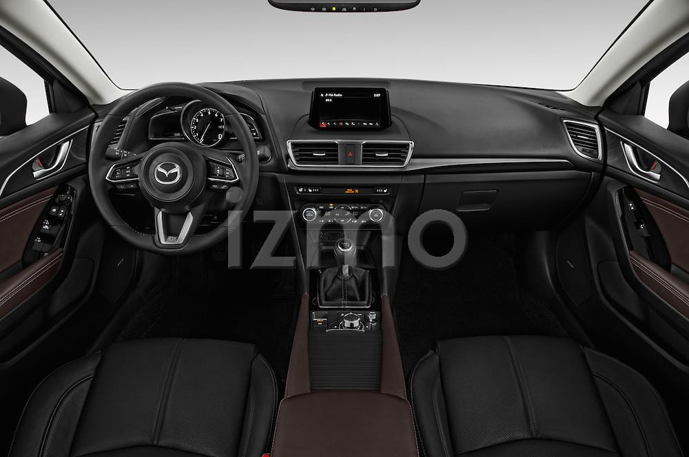 Stock photo of straight dashboard view of 2018 Mazda Mazda3 Grand-Touring 5 Door Hatchback Dashboard