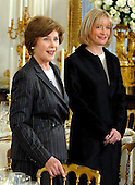 Washington, D.C. - May 7, 2007 -- First lady Laura Bush, left, and White House Social Secretary Amy Zantzinger preview the place settings in the State Dining Room for the State Dinner honoring Her Majesty Queen Elizabeth II and His Royal Highness The Prince Philip, Duke of Edinburgh of Great Britain in the White House in Washington, D.C. on Monday, May 7, 2007.  .Credit: Ron Sachs / CNP