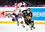 Stockholm 2014-09-11 Ishockey Hockeyallsvenskan AIK - S&ouml;dert&auml;lje SK :  <br /> AIK:s Victor Ekarv i kamp om pucken med S&ouml;dert&auml;ljes Simon L&ouml;f <br /> (Foto: Kenta J&ouml;nsson) Nyckelord:  AIK Gnaget Hockeyallsvenskan Allsvenskan Hovet Johanneshovs Isstadion S&ouml;dert&auml;lje SK SSK