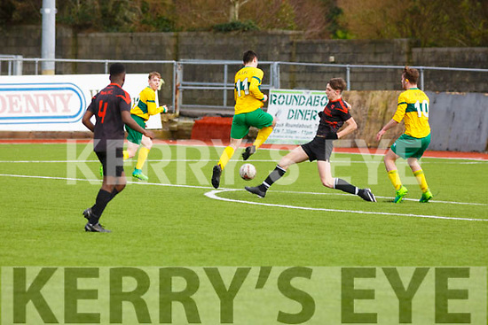 St Brendan's Park's James Sheehan attempts to block Keith O'Kelly of Ballingarry in the Munster Youth Cup Quarter-Final in Mounthawk Park on Saturday last.