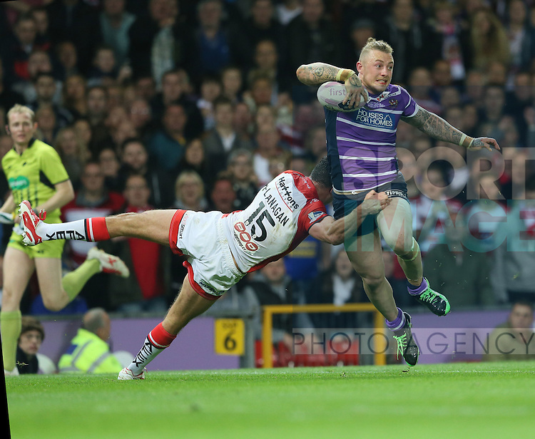Wigan Warriors Josh Charnley is tackled by St Helens Mark Flanagan- First Utility Super League Grand Final - St Helens v Wigan Warriors - Old Trafford Stadium - Manchester - England - 11th October 2014 - Pic Paul Currie/Sportimage