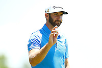 Dustin Johnson acknowledges the crowd after putting on the 16th green during the 2016 U.S. Open in Oakmont, Pennsylvania on June 17, 2016. (Photo by Jared Wickerham / DKPS)