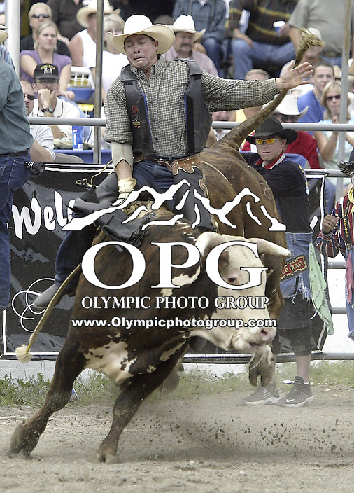 """29 Aug 2004: PRCA Rodeo Bull Rider Vic Dubray  riding the bull """"Feeling Lucky"""" during the PRCA 2004 Extreme Bulls competition in Bremerton, WA."""