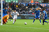 Tomas Holy of Gillingham (L) dives to catch the ball in front of Connor Roberts of Swansea City (C) during the FA Cup Fourth Round match between Swansea City and Gillingham at the Liberty Stadium, Swansea, Wales, UK. Saturday 26 January 2019