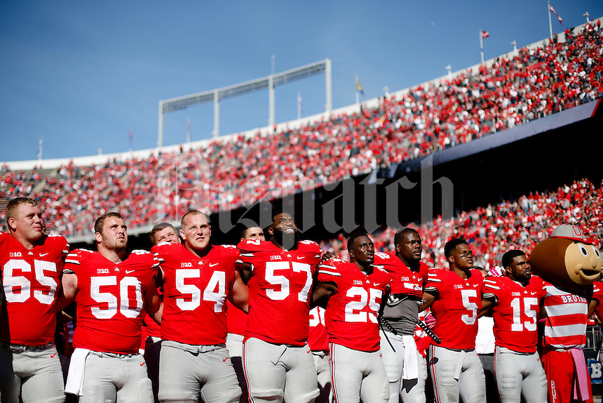 "Ohio State players sing ""Carmen Ohio"" following the Buckeyes 49-28 victory against the Maryland Terrapins on Saturday, October 10, 2015 at Ohio Stadium in Columbus, Ohio. (Joshua A. Bickel/The Columbus Dispatch)"