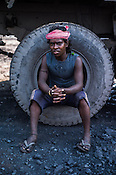 Mithun, a daily wage labourer poses for a portrait in Goladi coal depot in Jharia, outside of Dhanbad in Jharkhand, India.  Photo: Sanjit Das/Panos