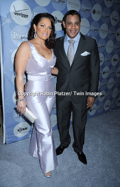 """Sonia and Sammy Sosa posing for photographers at the 14th Annual People En Espanol's """"50 Most Beautiful"""" issue on May 20, 2010 at .Guastavino's in New York City."""