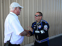 Jul, 22, 2012; Morrison, CO, USA: NHRA top fuel dragster driver Brandon Bernstein (right) with official Graham Light during the Mile High Nationals at Bandimere Speedway. Mandatory Credit: Mark J. Rebilas-US PRESSWIRE