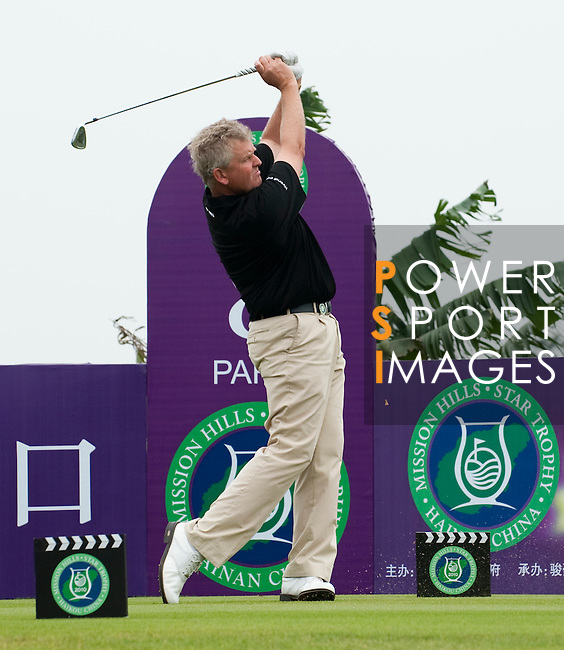 HAIKOU, CHINA - OCTOBER 31:  Colin Montgomerie of Scotland tees off on the 8th hole during day five of the Mission Hills Start Trophy at Mission Hills Resort on October 31, 2010 in Haikou, China.  The Mission Hills Star Trophy is Asia's leading leisure liflestyle event and features Hollywood celebrities and international golf stars. Photo by Victor Fraile / The Power of Sport Images