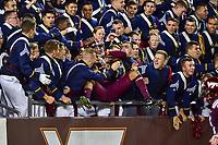 Blacksburg, VA - SEPT 30, 2017: Virginia Tech Hokies player is mobbed by Hokie fans during game between Clemson and Virginia Tech at Lane Stadium/Worsham Field Blacksburg, VA. (Photo by Phil Peters/Media Images International)