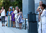 """A small crowd gathered at the State Capitol on Thursday, August 18, 2016 in Sacramento, California to celebrate the 96th anniversary of the ratification of the 19th Amendment to the United States Constitution granting women the right to vote.  Kate Van Buren, Mistress of Ceremony, introduced speakers, Gina Mulligan, author of """"Remember The Ladies"""", Angelique Ashby, Sacramento City Council, Nancy Compton, League of Women Voters, Katie McCleary, of 916 Ink and Rachel Michellin of CA Women Lead.  Singer-song writer Virginia Ayers Dawson began the event by singing the National Anthem and as a closing ceremony the group unfurled the banner for the Unity Banner For Hillary Project for a group photograph.  Singer-song writer, Virginia Ayers-Dawson sings the National Anthem to the audience.Photo/Victoria Sheridan 2016"""