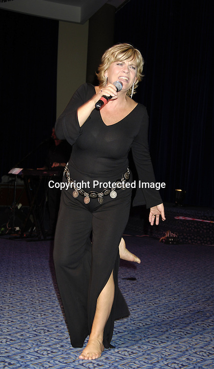 Kim Zimmer singing ..at the 11th Annual Daytime Television Salutes St. Jude Children's Research Hospital benefit hosted by Martha Byrne on October 14, 2005 at The New York Marriott Marquis Hotel. ..Photo by Robin Platzer, Twin Images