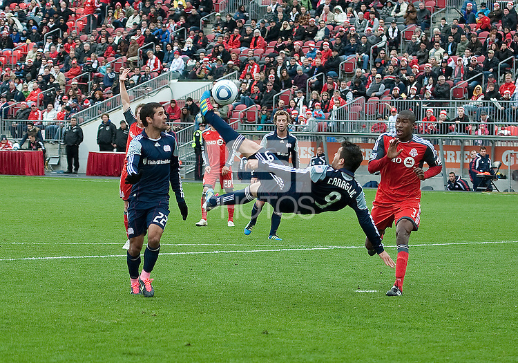22 October 2011: New England Revolution forward Milton Caraglio #9 in action during a game between the New England Revolution and Toronto FC at BMO Field in Toronto..The game ended in a 2-2 draw.