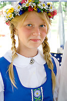 Teenager wearing garland and costume of Sweden. Svenskarnas Dag Swedish Heritage Day Minnehaha Park Minneapolis Minnesota USA