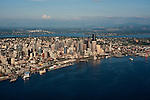 Aerial view of Seattle skyline with waterfront and ferry boat leaving ferry terminal