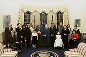 In this photo released by the White House, United States President Bill Clinton Commemorates the 25th Anniversary of the Individuals with Disabilities Act in the Oval Office of the White House in Washington,. DC on November 29, 2000. <br />
