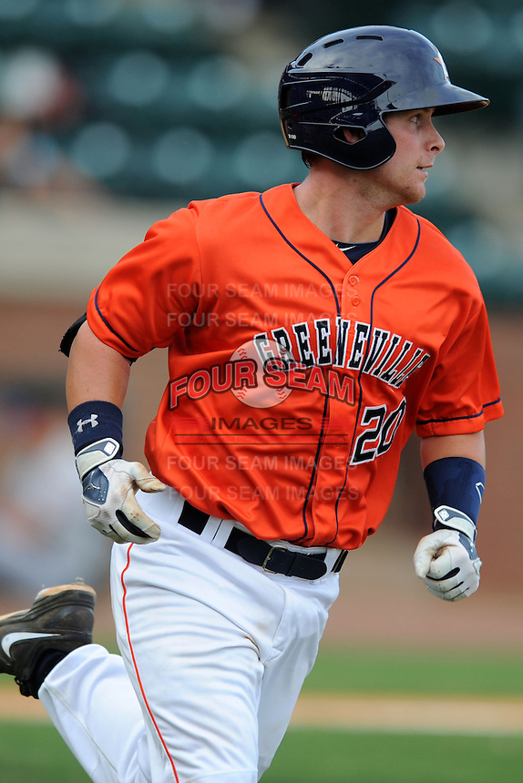 Greenville Astros catcher Brian Holberton #20 runs to first during a game against the Kingsport Mets at Pioneer Park on August 4, 2013 in Greenville, Tennessee. The Astros won the game 17-1. (Tony Farlow/Four Seam Images)