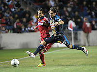 Philadelphia Union midfielder Gabriel Farfan (15) reaches for the ball in front of Chicago Fire midfielder Marco Pappa (16).  The Chicago Fire defeated the Philadelphia Union 1-0 at Toyota Park in Bridgeview, IL on March 24, 2012.