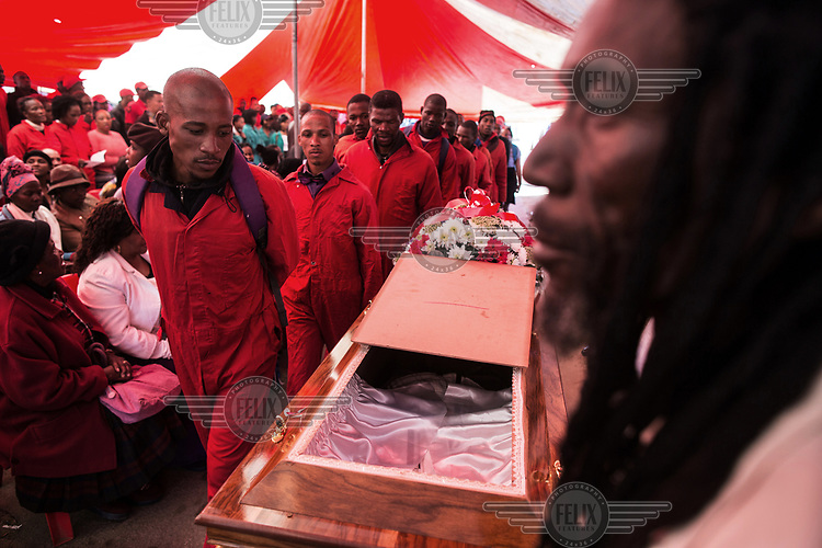 Funeral of Kervin Arthur Woods (46), a member of the Red Ants. He was killed during an eviction near Lenasia, South of Johannesburg. During the eviction, members of the community opened fire on the Red Ants. Woods was shot and wounded and then stabbed multiple times.<br />