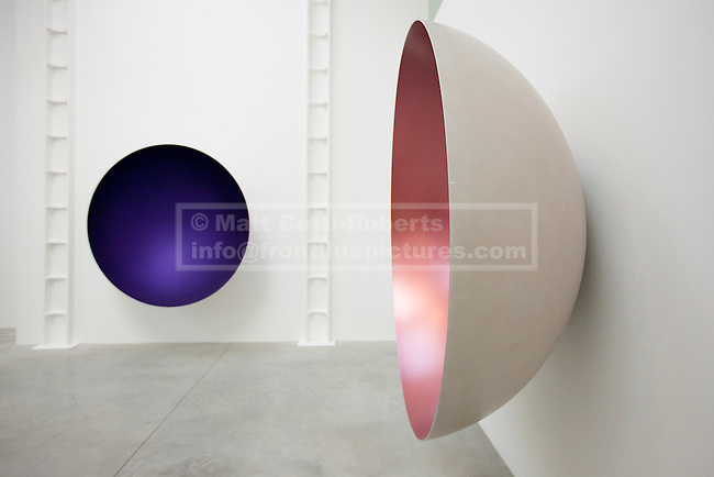 09/10/2012. LONDON, UK.  Anish Kapoor's sculptures 'Two Blues' (2012) (L) and 'Hollow' (2012) (R) are seen at a press view ahead of his new exhibition at the Lisson Gallery in London today (09/12/12) . The exhibition, the first since the artists solo exhibition at the Royal Academy of the Arts in 2009, features new works by Kapoor and runs from the 10th of October to the 10th of November 2012. Photo credit: Matt Cetti-Roberts