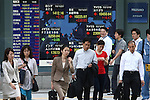 June 21, 2010 - Tokyo, Japan - Pedestrians walk past an electronic stock board at the Tokyo Stock Exchange in Tokyo, Japan, on June 21, 2010. The Nikkei 225 Stock Average rose 242.99 points, or 2.4%, to 10238.01, its highest closing level since May 18.