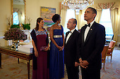 United States President Barack Obama, President Felipe Calderón of Mexico, First Lady Michelle Obama, and Mrs. Margarita Zavala, pause as the Military Color Guard enters the Yellow Oval Room of the White House, following a private reception, Wednesday, May 19, 2010. .Mandatory Credit: Pete Souza - White House via CNP