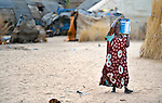 A woman in Timbuktu, a city in northern Mali which was seized by Islamist fighters in 2012 and then liberated by French and Malian soldiers in early 2013.  She belongs to the Bella ethnic group, which has traditionally been exploited by Timbuktu's lighter-skinned groups.