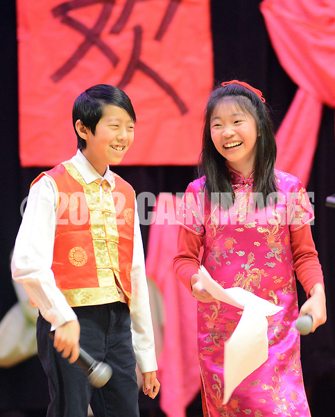 Patrick Wang (L) and Alice Zhu perform onstage as the Newtown-Yardley Chinese School celebrates Chinese New Year at Richboro Middle School Saturday February 21, 2015 in Richboro, Pennsylvania. (Photo by William Thomas Cain/Cain Images)