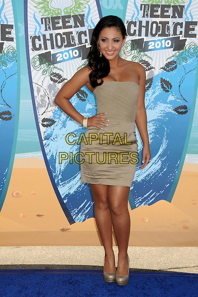 FRANCIA RAISA.Teen Choice Awards 2010 - Arrivals held at Universal Studios Gibson Amphitheatre, Universal City, California, USA.August 8th, 2010.full length beige grey gray strapless dress hand on hip gold  .CAP/ADM/BP.©Byron Purvis/AdMedia/Capital Pictures.