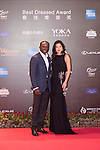 Dwight Yorke and Gaile Lai walk the Red Carpet event at the World Celebrity Pro-Am 2016 Mission Hills China Golf Tournament on 20 October 2016, in Haikou, China. Photo by Weixiang Lim / Power Sport Images