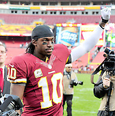 Washington Redskins quarterback Robert Griffin III gestures to the fans as he leaves the field following his team's 31 - 6 victory over the Philadelphia Eagles at FedEx Field in Landover, Maryland on Sunday, November 18, 2012.  .Credit: Ron Sachs / CNP