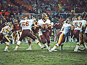 Washington Redskins quarterback Jay Schroeder (10) looks to pass in the game against the San Francisco Forty-Niners at RFK Stadium in Washington, D.C. on Sunday, December 1, 1985.  Pictured blocking for Schroeder are running back Keith Griffin (35), left tackle Joe Jacoby (66),  Raleigh McKenzie (63, and center Jeff Bostic (53).  The Forty-Niners won the game 35 - 8.<br /> Credit: Arnie Sachs / CNP