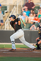 Jomar Reyes (20) of the Delmarva Shorebirds follows through on his swing against the Kannapolis Intimidators at CMC-Northeast Stadium on June 6, 2015 in Kannapolis, North Carolina.  The Shorebirds defeated the Intimidators 7-2.  (Brian Westerholt/Four Seam Images)