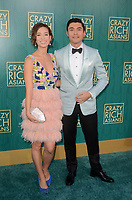 HOLLYWOOD, CA - AUGUST 7: Liv Lo and Henry Golding at the premiere of Crazy Rich Asians at the TCL Chinese Theater in Hollywood, California on August 7, 2018. <br /> CAP/MPI/DE<br /> &copy;DE//MPI/Capital Pictures