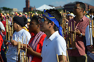 "July 9, 2011 (Washington, DC) More than 5,100 people gathered on the National Mall in Washington, DC to break a Guiness World Record by performing in the largest Angklung ensemble ever assembled. Mr. Daeng Udjo led the mass in playing ""We Are The World"" during the Indonesia Festival. The Angklung is an instrument made from joints of a piece of bamboo, and is played by being shaken.  Administrators from Guiness certified the record.  (Photo by Don Baxter/Media Images International)"