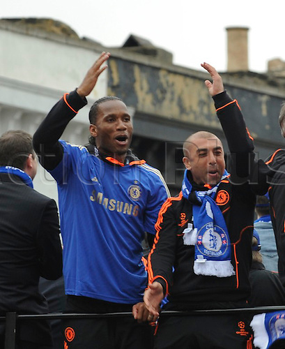 20.05.2012 Chelsea London, England..Champions League Cup Winners Parade atop the traditional open-top bus to the Stamford Bridge Ground. Picture shows Drogba and Di Mateo in the front of the bus